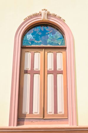 Window on the wall of church in thailand. photo