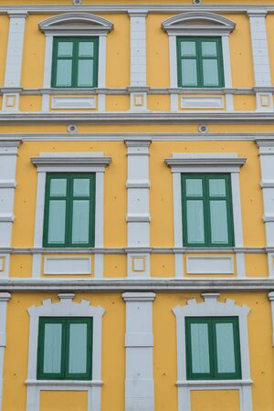 Yellow building and green windows Pattern
