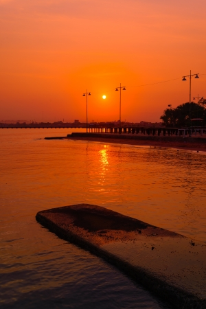 Sunset on the beach in pattaya province. photo