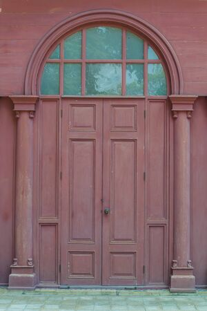 view of a wooden doorway: Beautiful door and window style from sanamchan castle Stock Photo