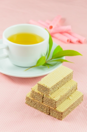 tea&biscuits on the pink table photo