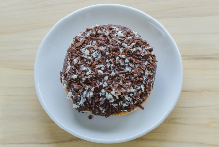 Chocolate donut on a white dish photo