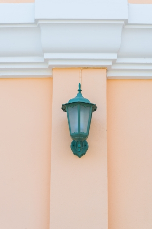 Beautiful vintage lamp on the wall photo