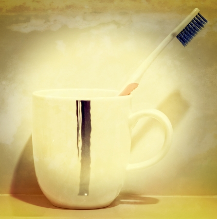 Tooth brush in a cup (Process in old vintage style) photo