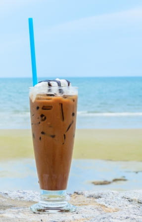 Iced coffee on the beach photo