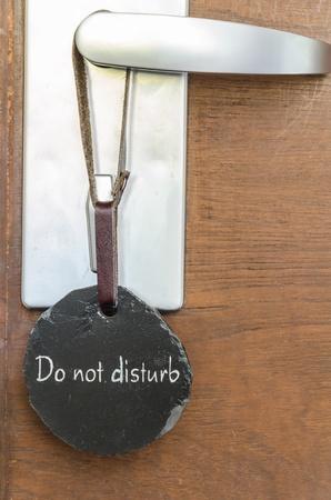 Sign  Do not disturb  on the door photo