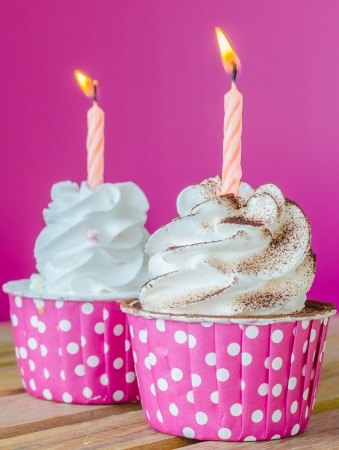 White cream cupcake with candle photo