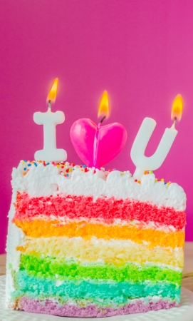 i love u: Rainbow cake with candle  I love u  Stock Photo