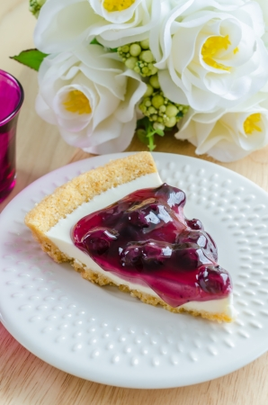 Blueberry cheese cake in white dish on the wood table Stock Photo - 20505128