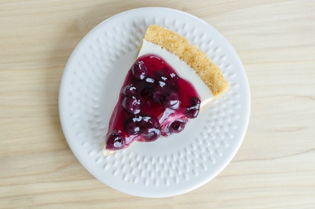 Blueberry cheese cake in white dish on the wood table Stock Photo - 20504594