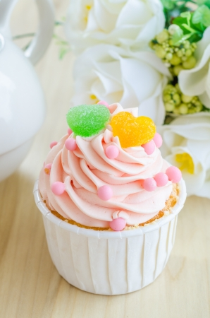 Strawberry cupcake on wood table photo