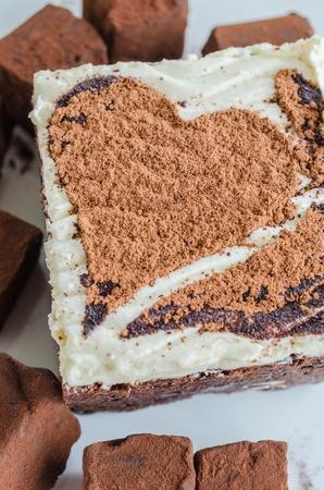 Brownie cake on white dish with chocolate photo