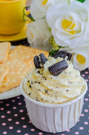 Vanilla cupcake with cookie photo