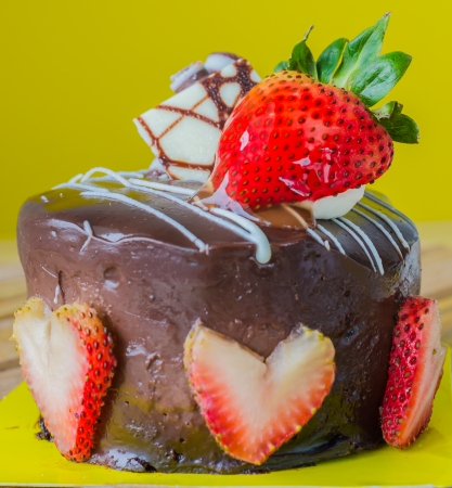 Chocolate cake with strawberry on top photo