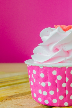 Pink Cupcake on color background photo