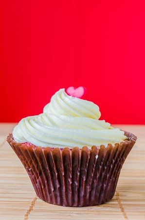 Vanilla cupcake on the table with colorful background photo