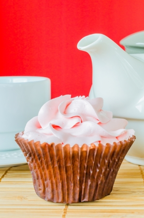 Pink cupcake on the table with colorful background Stock Photo - 20694427