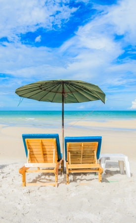 Chairs on the beautiful beach and blue sky in Thailand photo