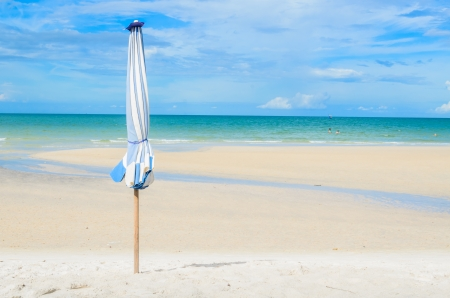 Umbrella on the beautiful beach and blue sky in Thailand photo