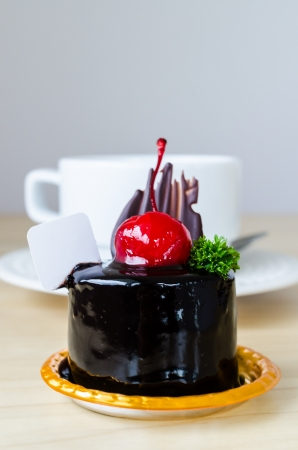 Chocolate cake with cherry on top photo