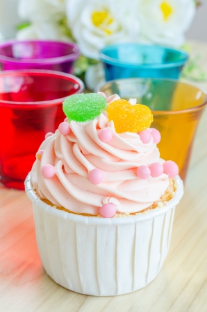 sugar paste: Strawberry cupcake on wood table Stock Photo