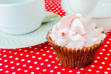 Pink cupcake on the table photo