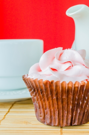 Pink cupcake on the table with colorful background Stock Photo - 20816652