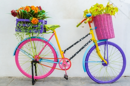 Fake flower in the vase on a bicycle