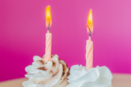 red velvet cupcake: White cream cupcake with candle Stock Photo