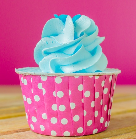 Mint Cupcake on color background photo
