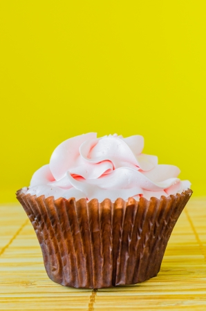 Pink cupcake on the table with colorful background Stock Photo - 20869187