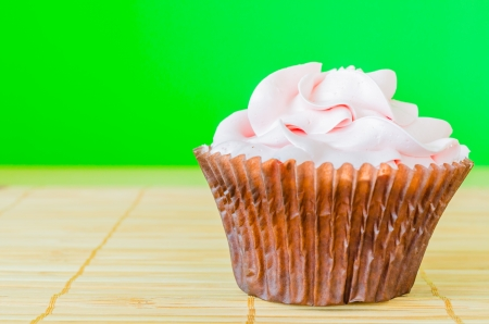Pink cupcake on the table with colorful background Stock Photo - 20869226