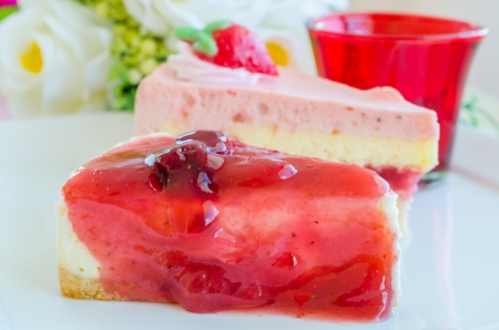 Strawberry cheese cake on white dish photo