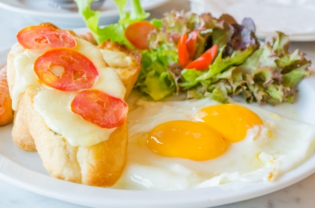 sunny side up: Breakfast set , fried egg , sausage , bread with tomato and cheese