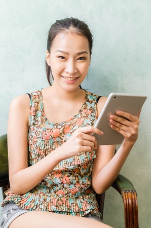 Young women smiling with tablet photo
