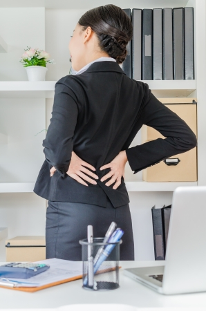 pain: Young business women back pain