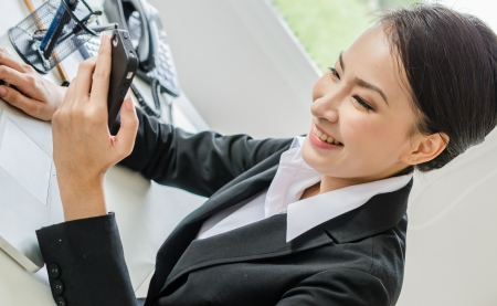 Young business women use moblie phone Stock Photo - 20980608