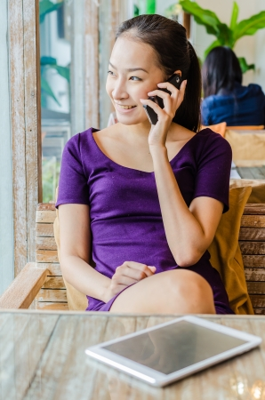 Young woman calling in restaurant photo