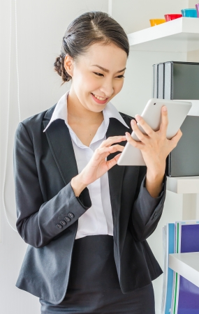 Young business woman use tablet with smiling Stock Photo - 20980808
