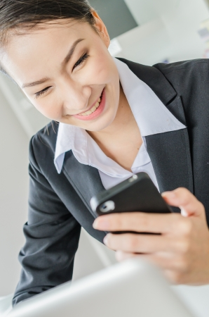 Young business women use moblie phone Stock Photo - 20980869