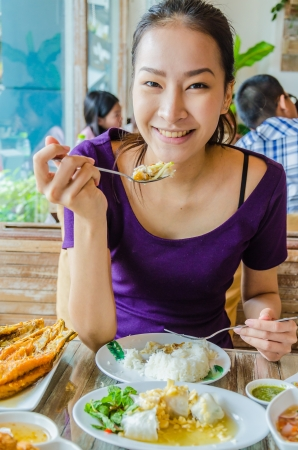 Girl in restuarant in eating action photo