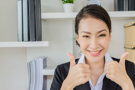 Young business women point finger with smiling photo