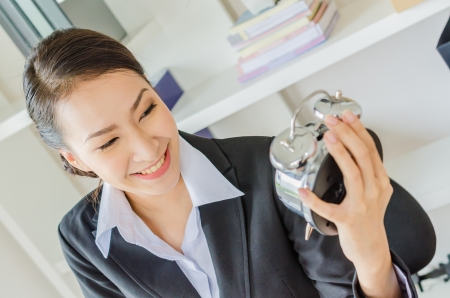 Young business women with clock photo