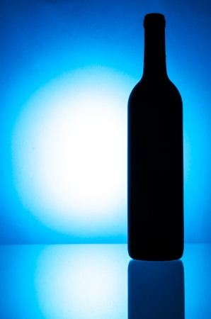 Wine bottle on blue background (Special process style) photo