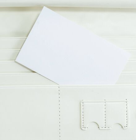 Surface white leather wallet with note photo