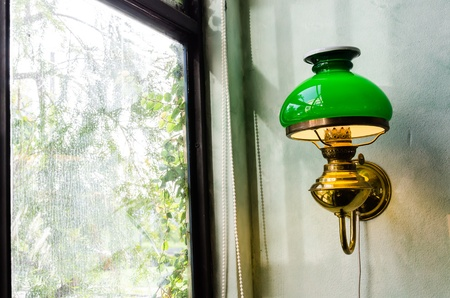 Old vintage lamp on the dirty wall photo