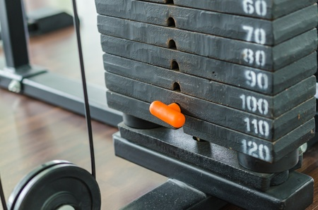 weight room: Weight plate for exercise in fitness room Stock Photo