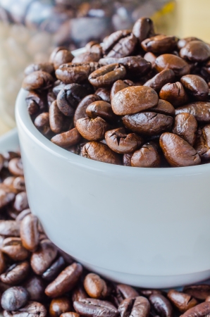 Coffee beans on white cup photo