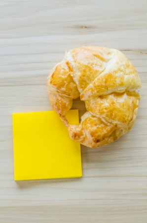 Croissant with paper note photo
