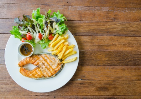 Top of view salmon steak on wood table photo